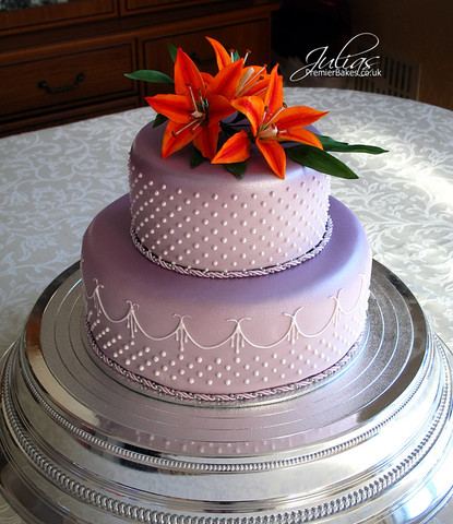 Elegant Wedding cake ..suited the occasion perfectly.  Two tier Chocolate cake with chocolate buttercream filling